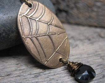 Queen of the Demonweb Pits II necklace ... sculpted bronze spiderweb with black spinel