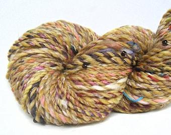 Handspun beaded Yarn handcarded BFL merino silk camel bamboo sparkle