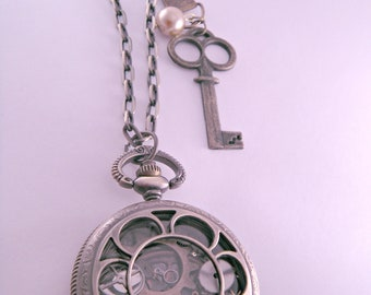Industrial Steampunk Brass Pocket Watch Body Filled With Watch Parts on 24 Inch Brass Chain with Skeleton Key and Pearl