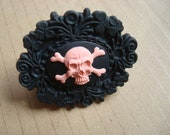 Pink skull and cross bones cameo ring