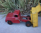 Vintage metal red and yellow TONKA TOY dump truck