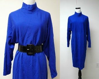 SALE!!! COLLECTIBLES . 1970 vintage  batwing . sweater dress . medium . made in USA