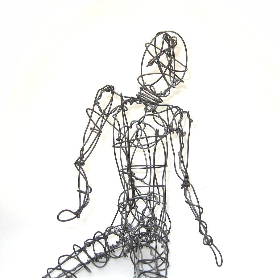 Twisted wire sculpture human figure seated by uncommoneye