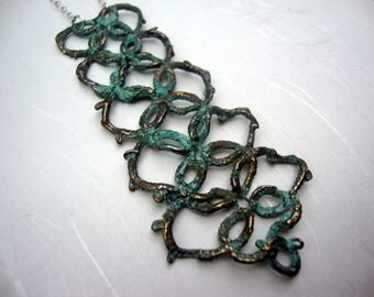 "Long""collar"" Lace necklace cast in bronze with blue patina"