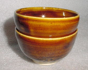 Set of Two Beautiful Wheel Thrown Pottery Tea Bowls in Amber with Swirls Inside