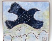 30% off shop wide SALE now!  hand carved ceramic art tile bird above the clouds