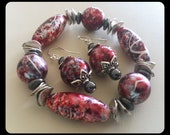 Red black and silver chunky resin beaded bracelet with matching dangle earrings