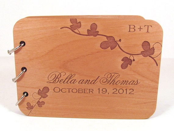 https://www.etsy.com/listing/113547521/wooden-wedding-guest-book-leafy-vine
