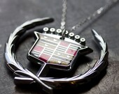 big bad CADDY CREST necklace - vintage CADILLAC