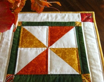 Quilted fall table mat in fall colors from Give Thanks from Moda