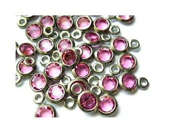 10 Vintage channel Swarovski  beads 1 self loops rose pink in silver color metal