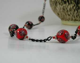 Beaded necklace, Little Red Flowers in Black