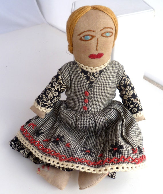 Folk Doll from Putmayo - made in India - black, red and white