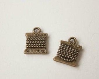 7pcs 11x14mm antique bronze bobbin charms pendants (J18)