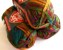 Red Heart Soft yarn,  JEWEL TONE Print, red purple green teal yellow rainbow,  medium worsted weight