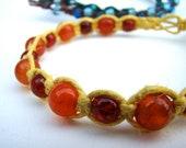 Hemp Bracelet-- Orange Dragon's Vein Agate and Red Cracked Glass Beads in Yellow Fiber