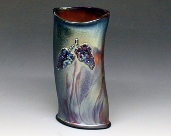 Raku Oval Vase with GrapesIn Copper, Fuscia, Blue Metallic and Iridescent Colors