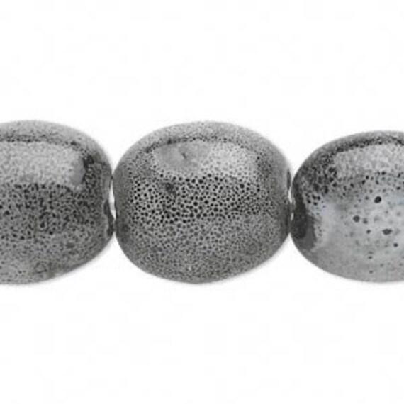 Bead, ceramic, black and white, 20x16mm oval. Sold per 16-inch strand