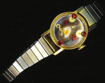 Steam punk Mobe Pearl Bracelet . Upcycled / Recycled Stretchy Watch Band. Adjustable . Red Rhinestones - Steampunk by enchantedbeas on Etsy