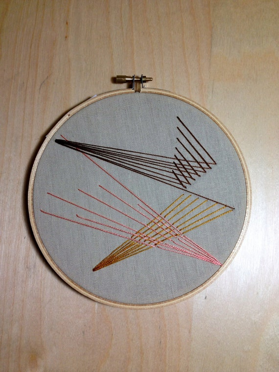 Geometric embroidered wall hanging embroidery hoop