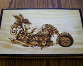 Pyrography or Woodburning Art Angel on a Motorcycle Made of Skulls and Bones