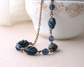 Black and Blue necklace with vintage sapphire blue glass