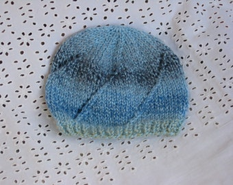 Knitted baby hat - lace pattern in blue shades