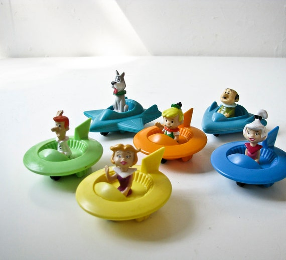 The Jetson Family In Their Flying Saucer Vehicles