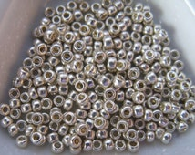 Toho 11/0  size 11 round Permanent Finish Galvanized Silver Seed Beads (color P470/TP558)  approx. 28 Grams