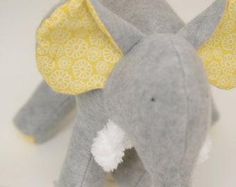 Missy Grey - Plush Gray Fleece Elephant with yellow and white flowers on her tummy and soft chenille tusks