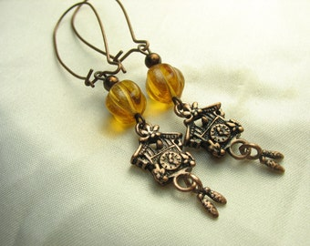 Cuckoo clock earrings ... little clocks with amber glass beads ... tick tock