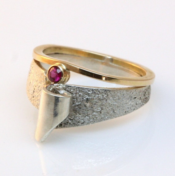 Ruby, gold and silver ring