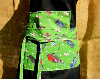 GOLFERS PARADISE black chef apron with green golf themed pockets and ties
