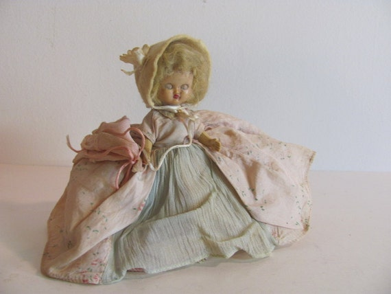 small Vintage antique BABY doll with jointed arms and legs and gorgeous dress