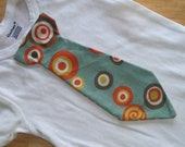 Last one...Baby tie onesie or shirt with blue gray, orange and yelllow circles...last one for Easter