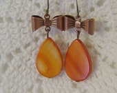 Cute Orange Shell Earrings With A Bow