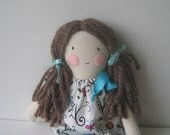 Rag doll, cloth doll, fabric doll, stuffed doll with brown hair and pillowcase dress featuring an enchanted garden.