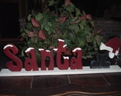 Snow covered Santa Letters with Santa Boots and Hat