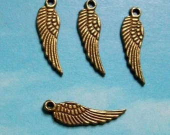 20 tiny wing charms, bronze tone, 17mm