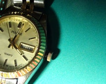 Vintage Ladies Pulsar Watch gold Plated and  Working Quartz from 1980s Day and Number and back of the watch 955962  On SaLe Now