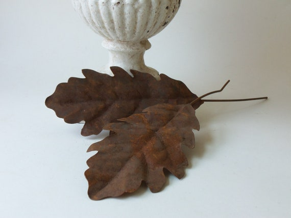 two vintage rusty tin leaves