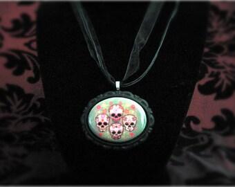 Four skulls cameo necklace