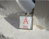 "Swedish Letters ""Desire"" - square silver and red pendant with chain"
