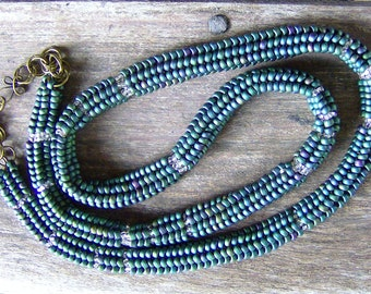 Classic Czech old world elegant turquoise beads with iris wash are handwoven into a sophisticated herringbone design accented crystal bead