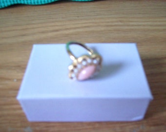 Vintage Avon Faux Coral  and pearl goldtone ring. From the 1970s.