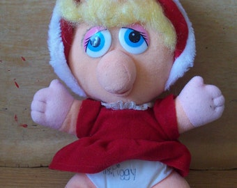 Baby Miss Piggy, Jim Henson's Christmas doll for McDonalds..