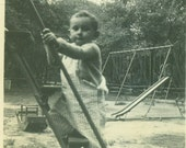 Climbing Up Sliding Board Ladder Little Boy in Striped Overalls 1940s Park Playground Vintage Black and White Photo Photograph