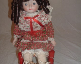 VINTAGE collectible  doll with red straw chair