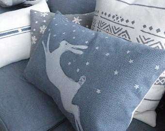 Exclusive hand printed pewter  leaping  hare  in snow cushion cover