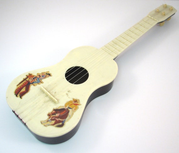 vintage plastic toy cowboy ukulele by vintagecreekside on etsy. Black Bedroom Furniture Sets. Home Design Ideas